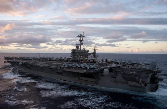 The Nimitz-class aircraft carrier USS John C. Stennis steams through the Pacific Ocean after departing Bremerton for deployment in October. The Stennis will call Norfolk home following deployment as it undergoes a midlife refueling.