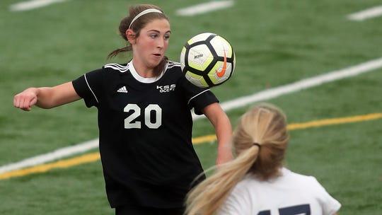 Klahowya's Alyssa Peters (20) heads the ball as Cascade Christian's Elizabeth Jennings (17) closes in girls at Silverdale Stadium on Thursday, November 1, 2018.