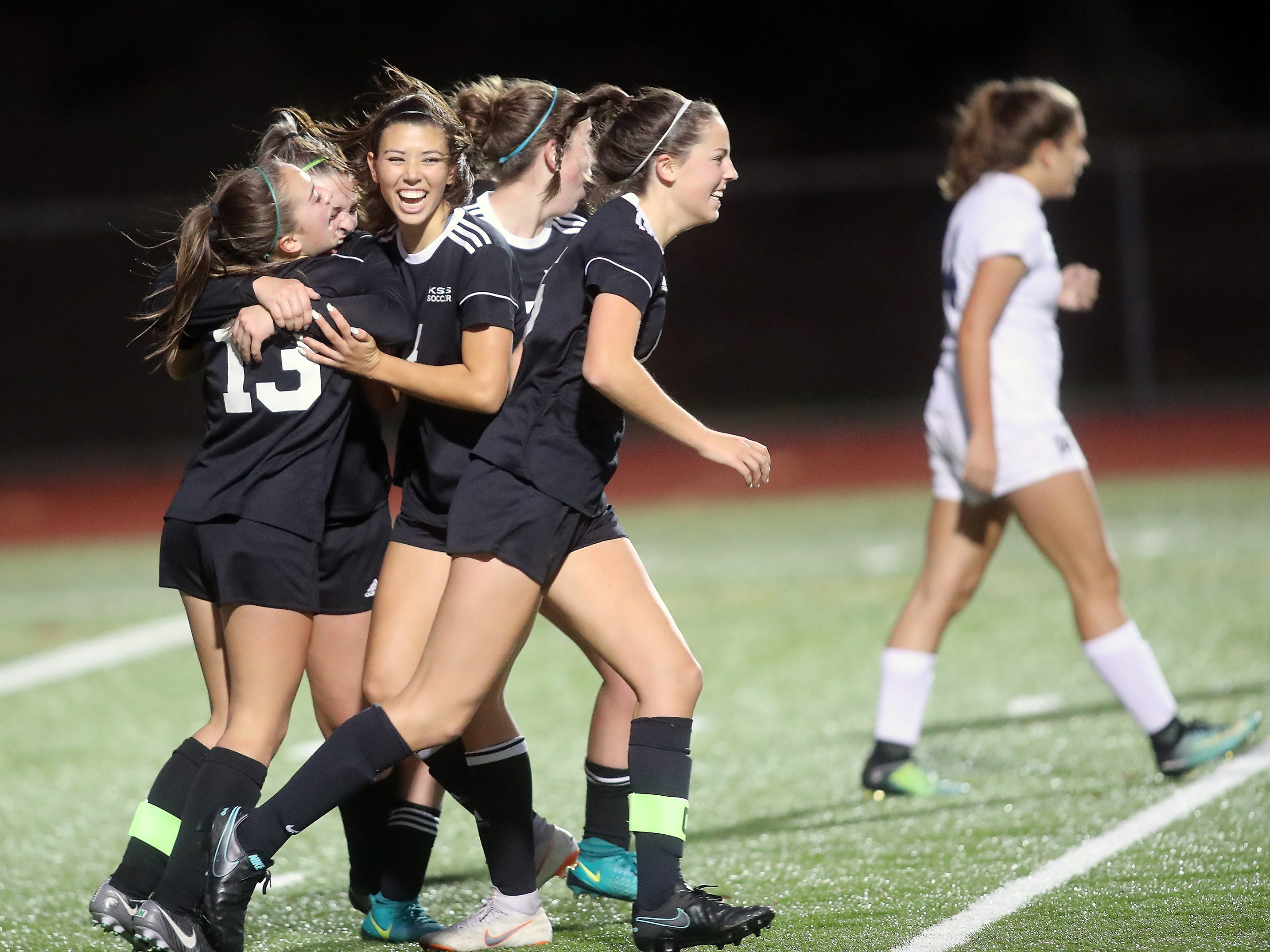 Klahowya players celebrate Kayden Eckley's goal against Cascade Christian at Silverdale Stadium on Thursday, November 1, 2018.