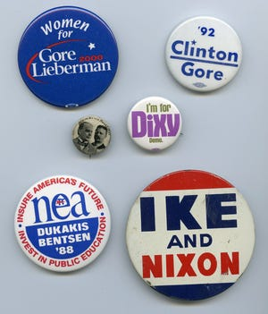 The 1900 William McKinley/Theodore Roosevelt presidential campaign button is the oldest in the Kitsap County Historical Society collection. The other buttons include the 1956 Eisenhower-Nixon presidential button and the 1976 button for Dixie Lee Ray's gubernatorial race.