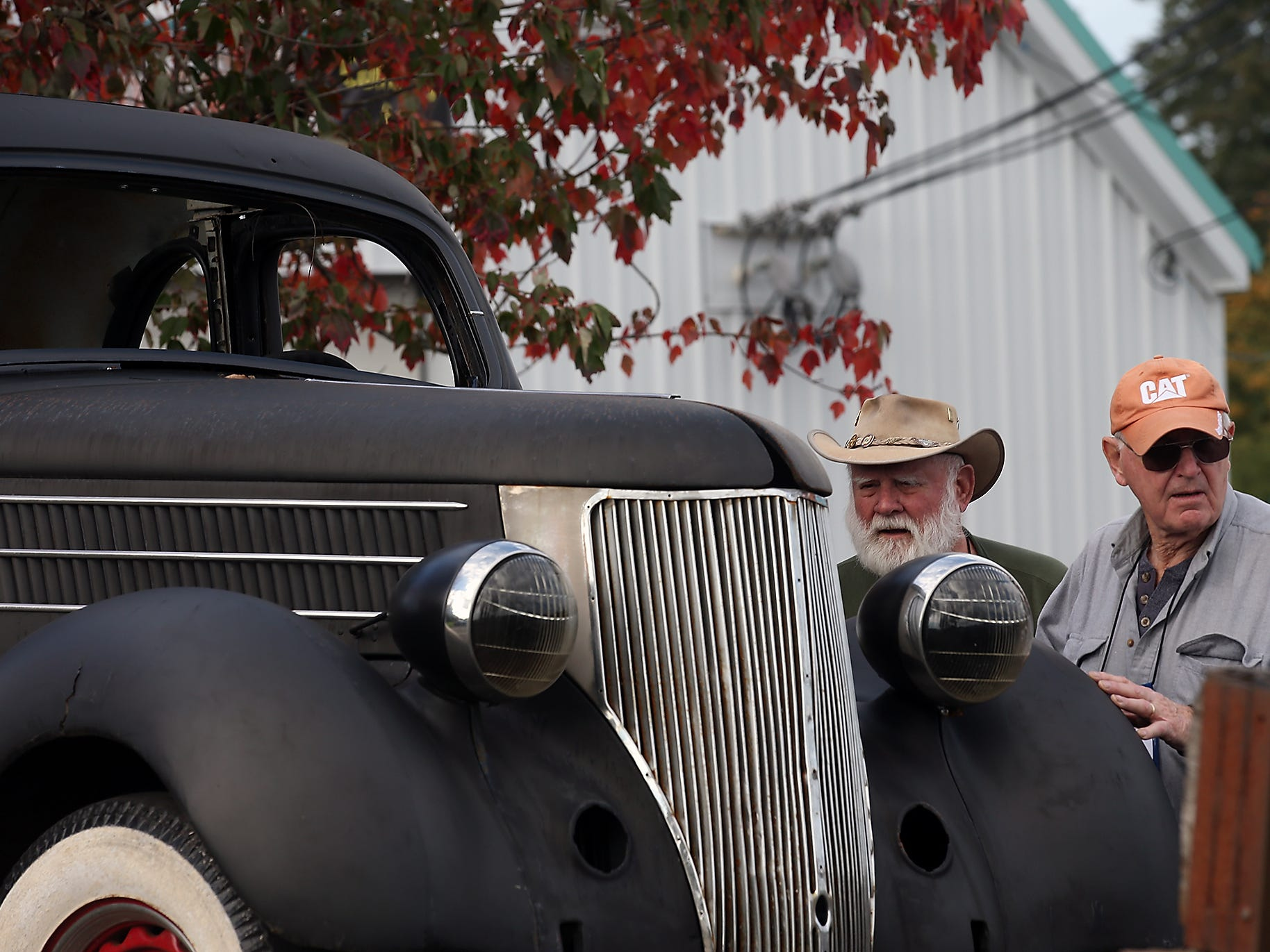 Ted Austin, of Poulsbo, (left) and Fred Sears, of Bremerton,  look over a 1939 Ford car body for sale as they help setup for the the annual Olympic Vintage Auto Club Swap Meet at the Kitsap County Fairgrounds on Friday, November 2, 2018.