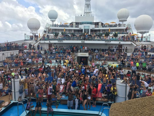 Guests on board the Carnival Sunshine party on the deck. This week there was a malfunction with the ship, causing it to tilt to one side, before it returned to Port Canaveral on Nov. 2, 2018.