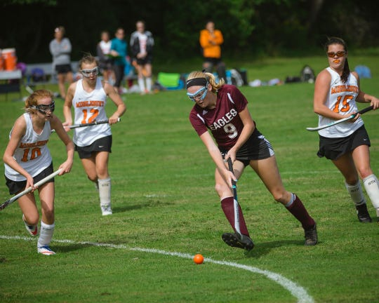 Mount Abraham's Jalen Cook in action during a high school field hockey playoff game vs. Middlebury.