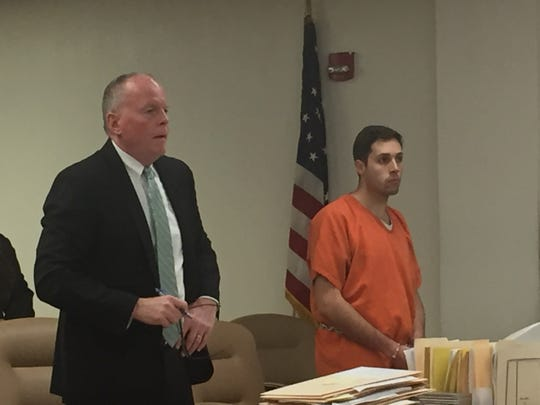 Brantley Cesanek and attorney Thomas Huth attend a detention hearing Friday for the Cherokee High School teacher.