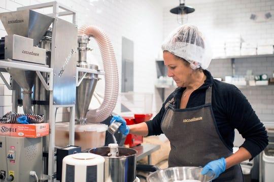Owner Deborah Pellegrino works in the kitchen at MADE Atlantic City Chocolate Bar in Atlantic City, N.J.