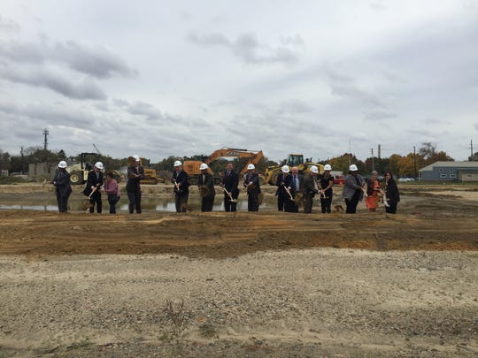 Officials from the City of Camden, Camden Housing Authority, The Michaels Organization, U.S. Dept. of Housing and Urban Development and others break ground on a new townhome development in Centerville.