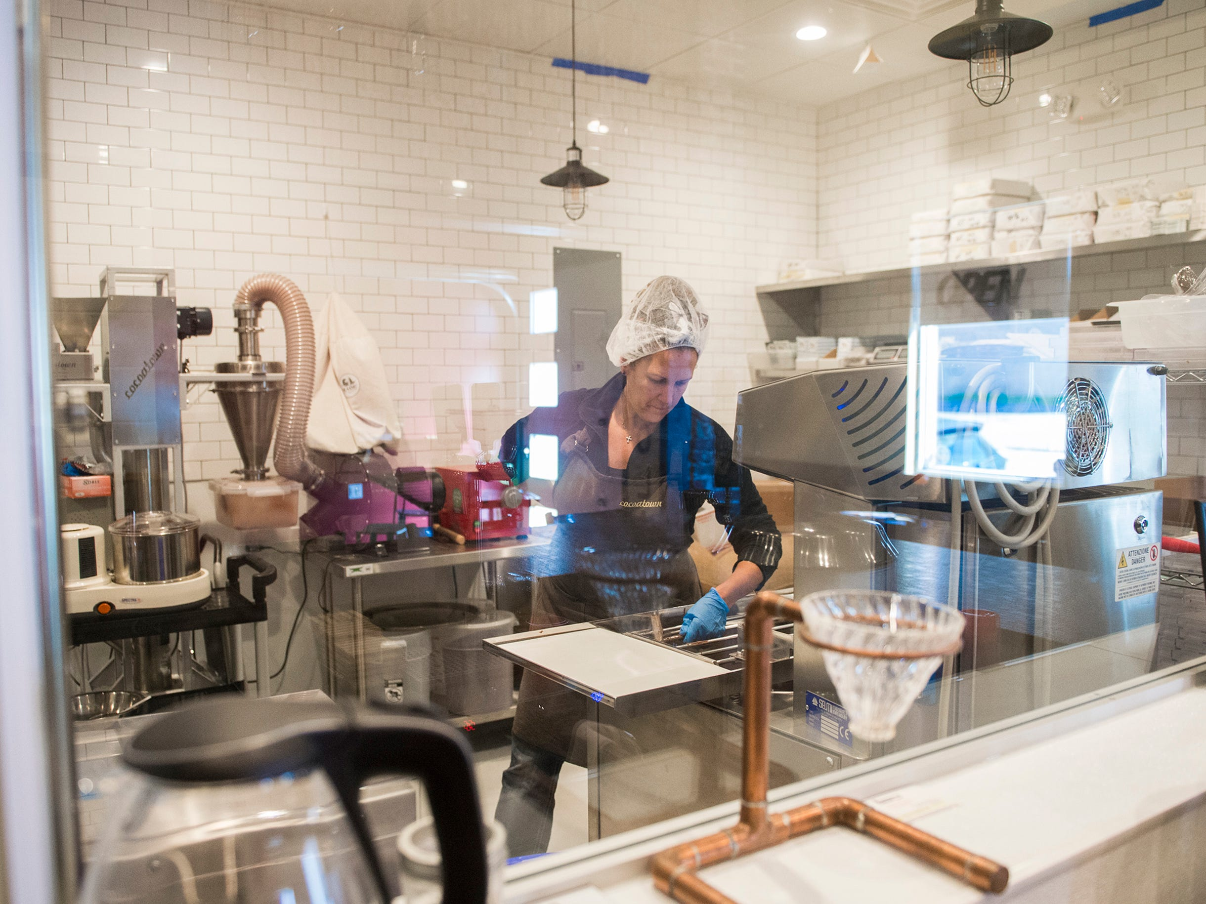 Owner Deborah Pellegrino works in the kitchen at MADE Atlantic City Chocolate Bar in Atlantic City, N.J.