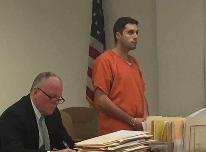 Brantley Cesanek appears at a detention hearing Friday with defense attorney Thomas Huth.