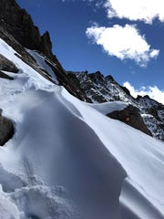Chest-deep snow on Longs Peak in Colorado has stopped the search for missing hiker Ryan Albert of Marlton.
