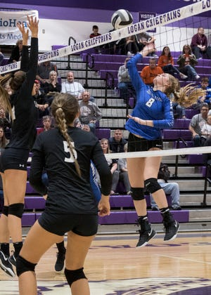 Southeastern' s Hannah Lougheed spikes the ball against Berlin Hiland Thursday night at Logan High School during a Division III volleyball regional semifinals game. Southeastern defeated Berlin Hiland 3-1 and will play against Tuscarawas Valley Saturday for the regional final.