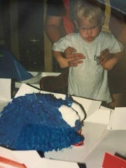 """Theresa Johnson remembers the time she bought a """"Blue Light"""" special cake for her nephew's second birthday in 1997, thinking it was Cookie Monster from Sesame Street. The reaction, as you can see from this photo she submitted, is priceless."""