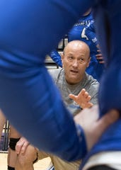 Southeastern head coach Jimmy Hutton talks to team during a regional semifinal in 2018. Hutton resigned from his head coaching position with the Panthers, the Gazette confirmed on Wednesday.