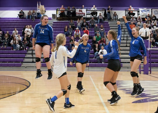 Southeastern volleyball celebrates after defeating Berlin Hiland 3-1 at Logan High School during a Division III volleyball regional semifinals game.