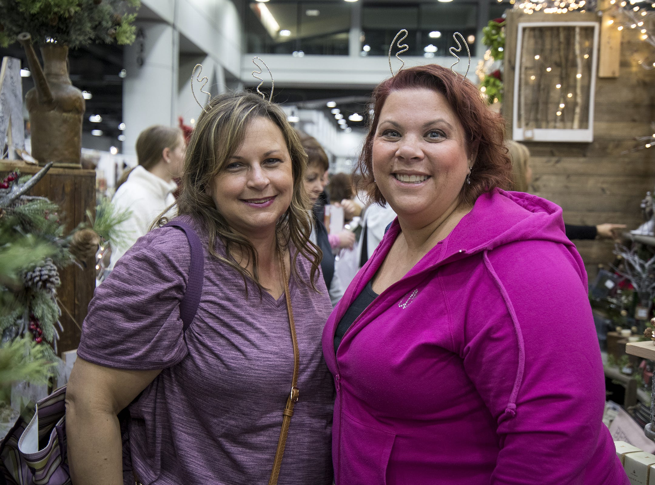 Vanessa Cline of Greendale, Indiana and Nikki Beninghaus of Bridgetown check out a booth during the Greater Cincinnati Holiday Market at the Duke Energy Center Friday, November 2, 2018 in Cincinnati, Ohio. The event runs through Sunday, November 4.