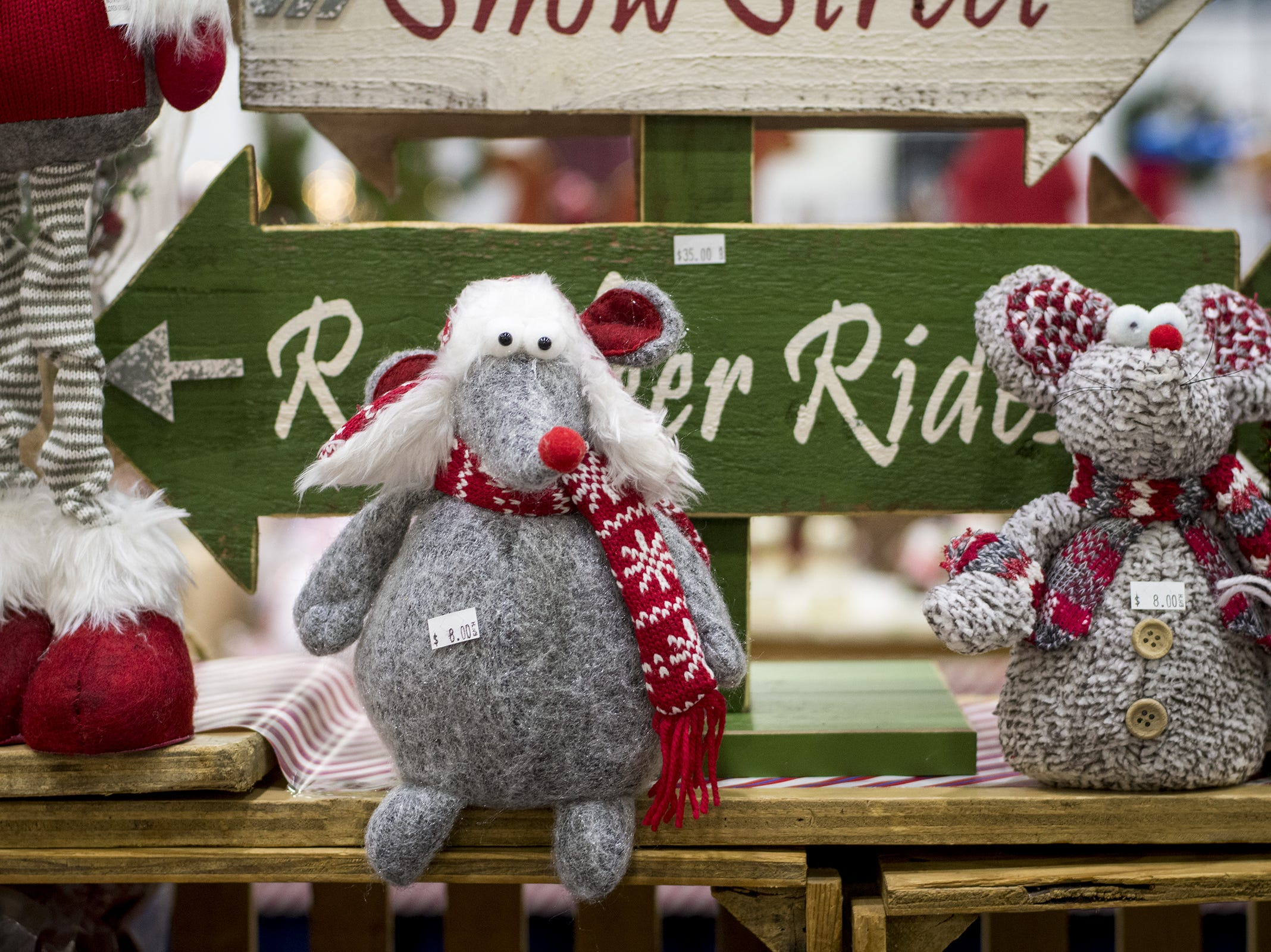 T&T Gifts sells adorable holiday signs and decorations during the Greater Cincinnati Holiday Market at the Duke Energy Center Friday, November 2, 2018 in Cincinnati, Ohio. The event runs through Sunday, November 4.