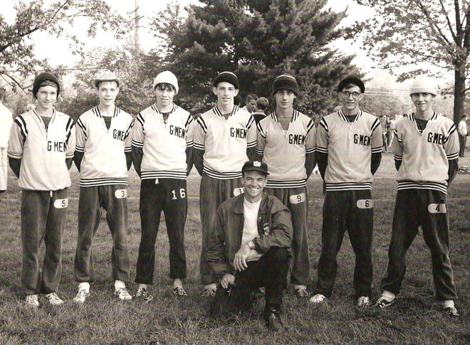 The 1969 Georgetown cross country state championship team included, from left: Mike Bends, Craig Jurin, Dan Lindsey, Dave Warner, Denny Brooks, Rick Brown, Jeff Green and coach Vern Hawkins in the front