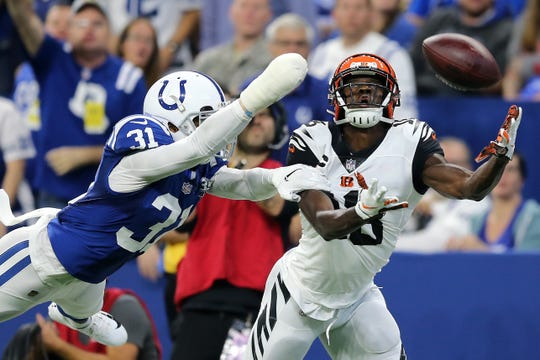 Indianapolis Colts cornerback Quincy Wilson (31) is called for pass interference as Cincinnati Bengals wide receiver A.J. Green (18) tries to make a catch in the second quarter during the Week 1 NFL game between the Cincinnati Bengals and the Indianapolis Colts, Sunday, Sept. 9, 2018, at Lucas Oil Stadium in Indianapolis.