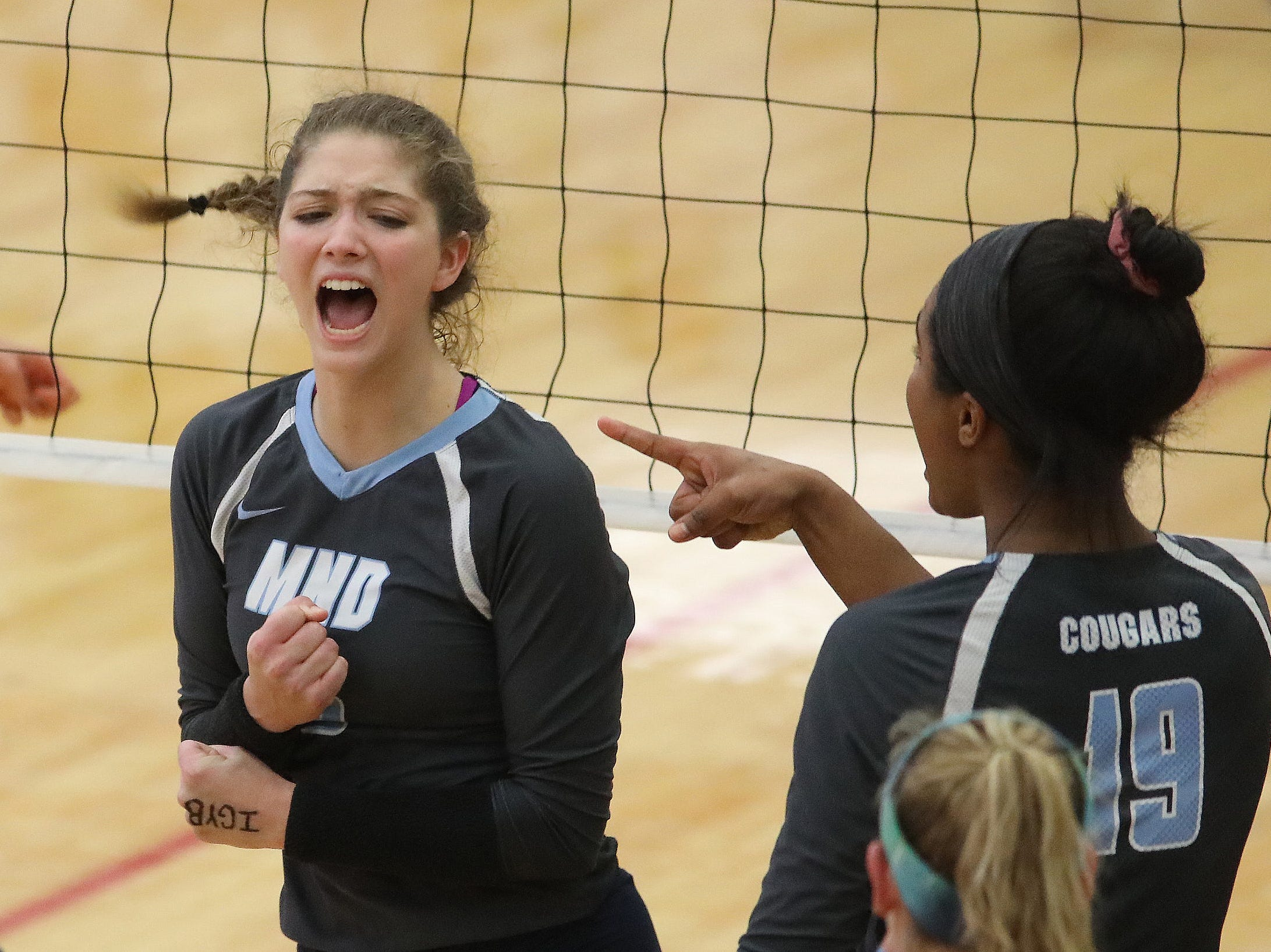 Mount Notre Dame player Samantha Wolf reacts during their regional volleyball game against Mercy-McAuley, Thursday, Nov. 1, 2018.
