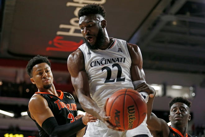Cincinnati Bearcats forward Eliel Nsoseme (22) pulls down a rebound in the first half of an exhibition game between the University of Cincinnati Bearcats and the Tusculum Pioneers at Fifth Third Arena on the University of Cincinnati campus in Cincinnati on Tuesday, Oct. 16, 2018.