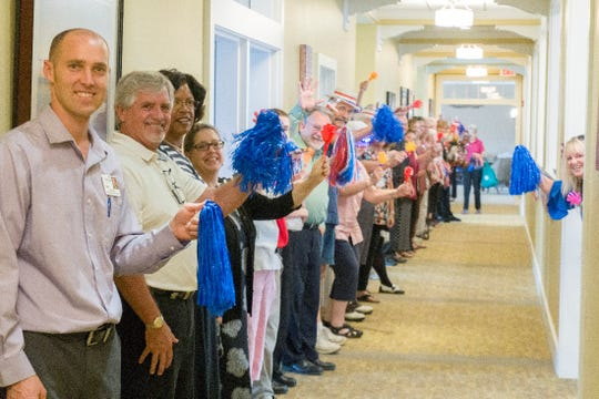 Otterbein Senior Life employees and friends lined the halls to welcome 85-year-old pole vault gold medalist Bob Arledge home with a Celebration Parade.
