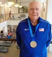 Bob Arledge proudly wore the U.S. track suit while winning the gold medal in Malaga, Spain, during the World Masters Track and Field Championships Sept. 12.