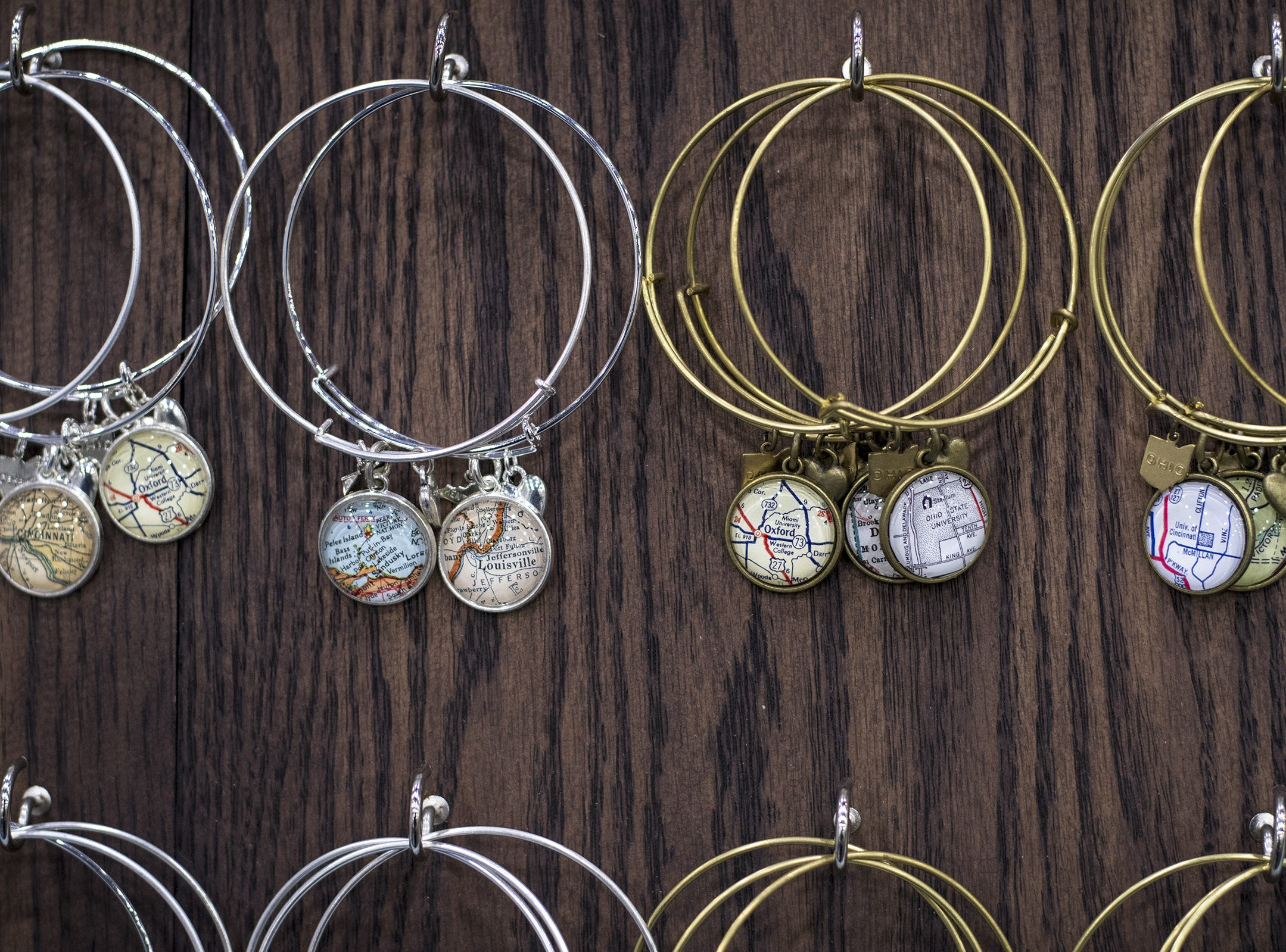 Daisy Mae Designs sells handmade jewelry featuring maps of special places during the Greater Cincinnati Holiday Market at the Duke Energy Center Friday, November 2, 2018 in Cincinnati, Ohio. The event runs through Sunday, November 4.