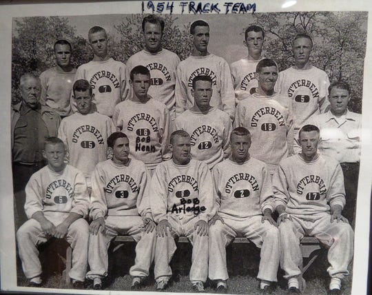 Photo of the 1954 Otterbein College track team featuring 20-year-old future World Masters Gold Medal pole vaulter Bob Arledge in middle of the front row.