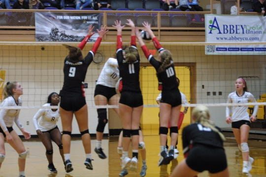 Tippecanoe High School players block a shot from Monique Gentry of Roger Bacon at Butler High School in the 2018 Girls Division II Volleyball Regional Semifinals, Nov. 1, 2018.