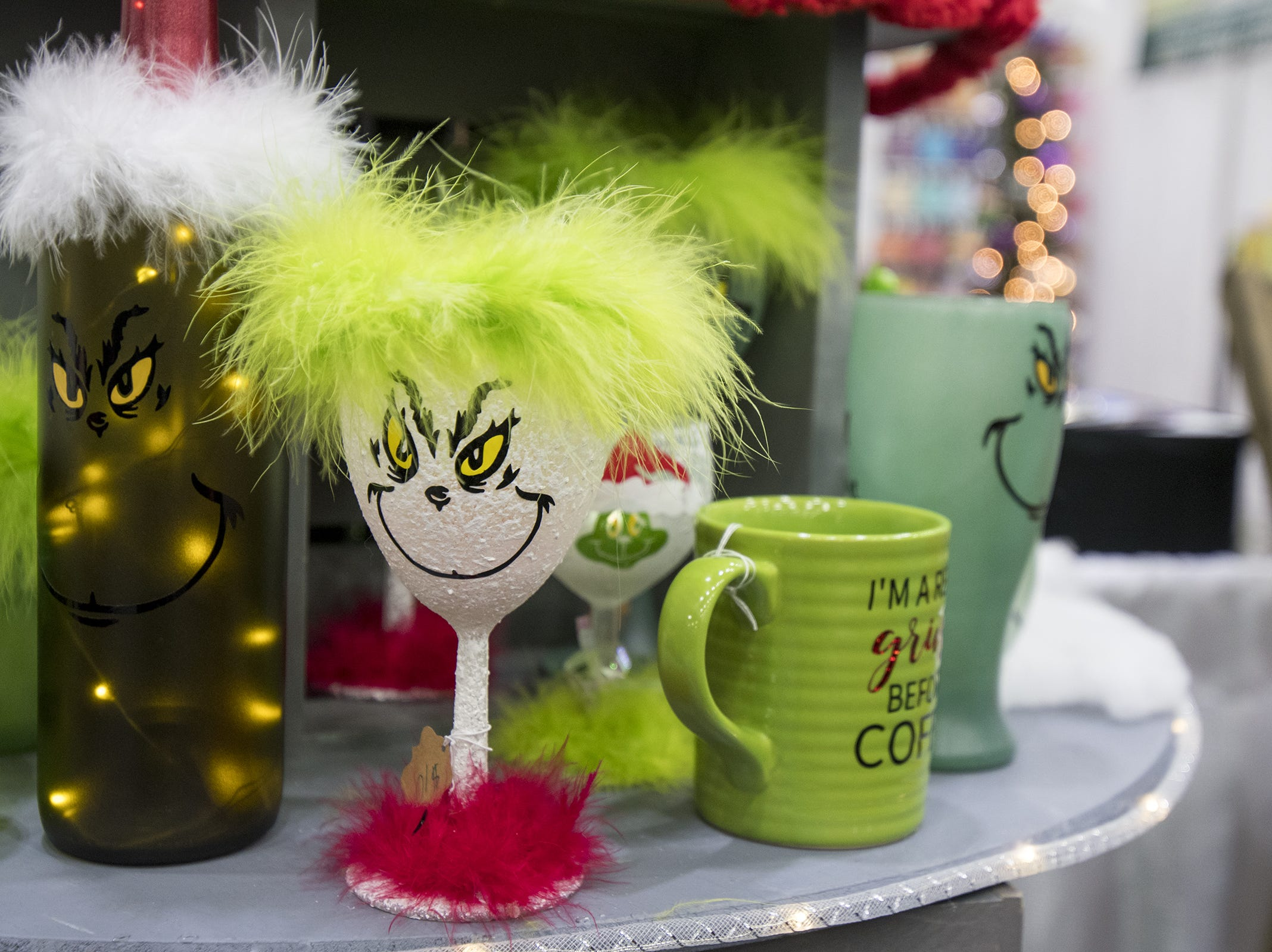 Kiri Creative Designs sells tons of Grinchy goods during the Greater Cincinnati Holiday Market at the Duke Energy Center Friday, November 2, 2018 in Cincinnati, Ohio.