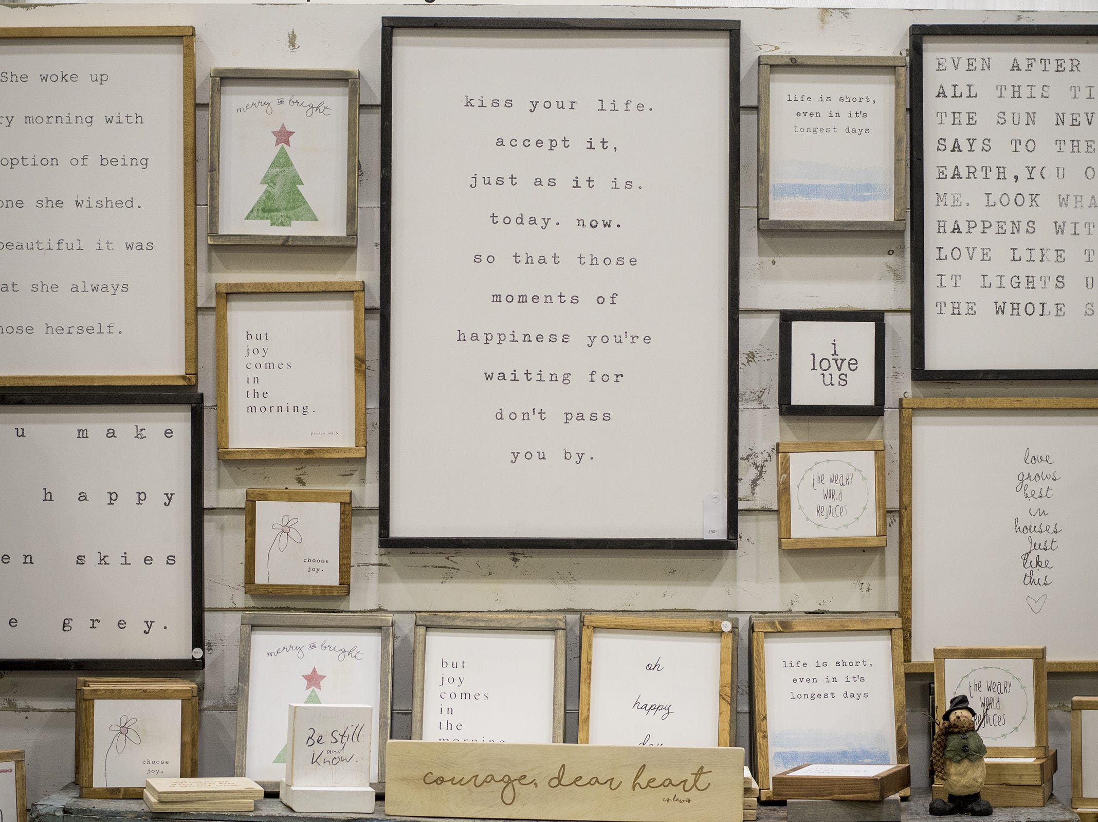 Harpers Design Co. showcases framed saying and art during the Greater Cincinnati Holiday Market at the Duke Energy Center Friday, November 2, 2018 in Cincinnati, Ohio. The event runs through Sunday, November 4.