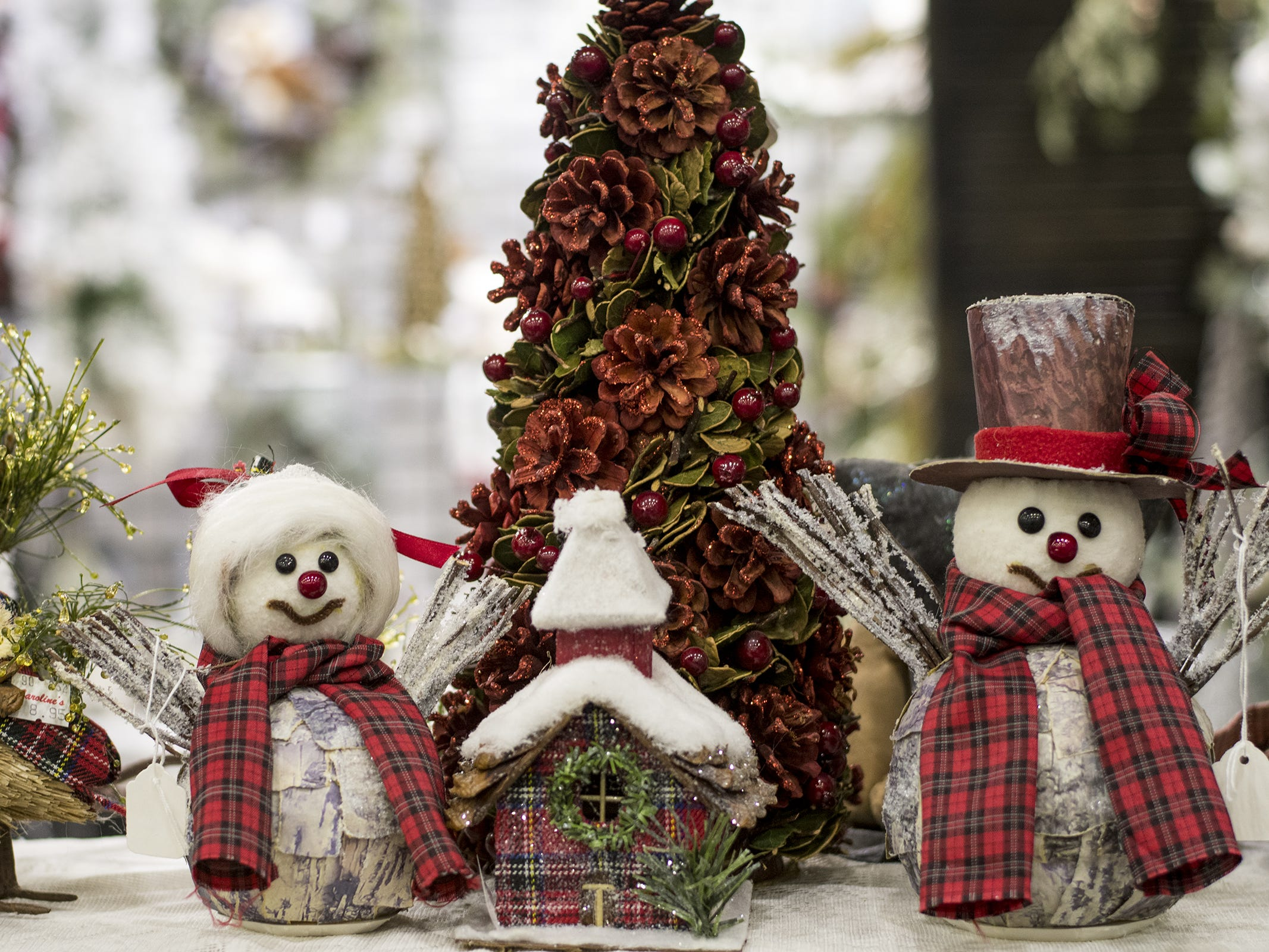 Caroline Collectibles offers holiday decorations and knick-knacks during the Greater Cincinnati Holiday Market at the Duke Energy Center Friday, November 2, 2018 in Cincinnati, Ohio. The event runs through Sunday, November 4.