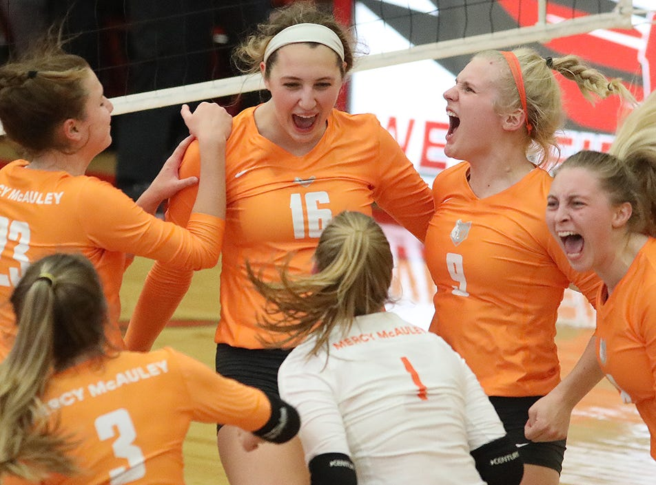 Mercy McAuley players react during their regional volleyball game against  MND , Thursday, Nov. 1, 2018.