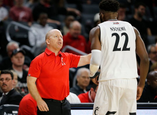 Cincinnati Bearcats head coach Mick Cronin questions forward Eliel Nsoseme (22) after a play in the second half of an exhibition game between the University of Cincinnati Bearcats and the Tusculum Pioneers at Fifth Third Arena on the University of Cincinnati campus in Cincinnati on Tuesday, Oct. 16, 2018. The Bearcats won the season-opining exhibition game, 68-41.