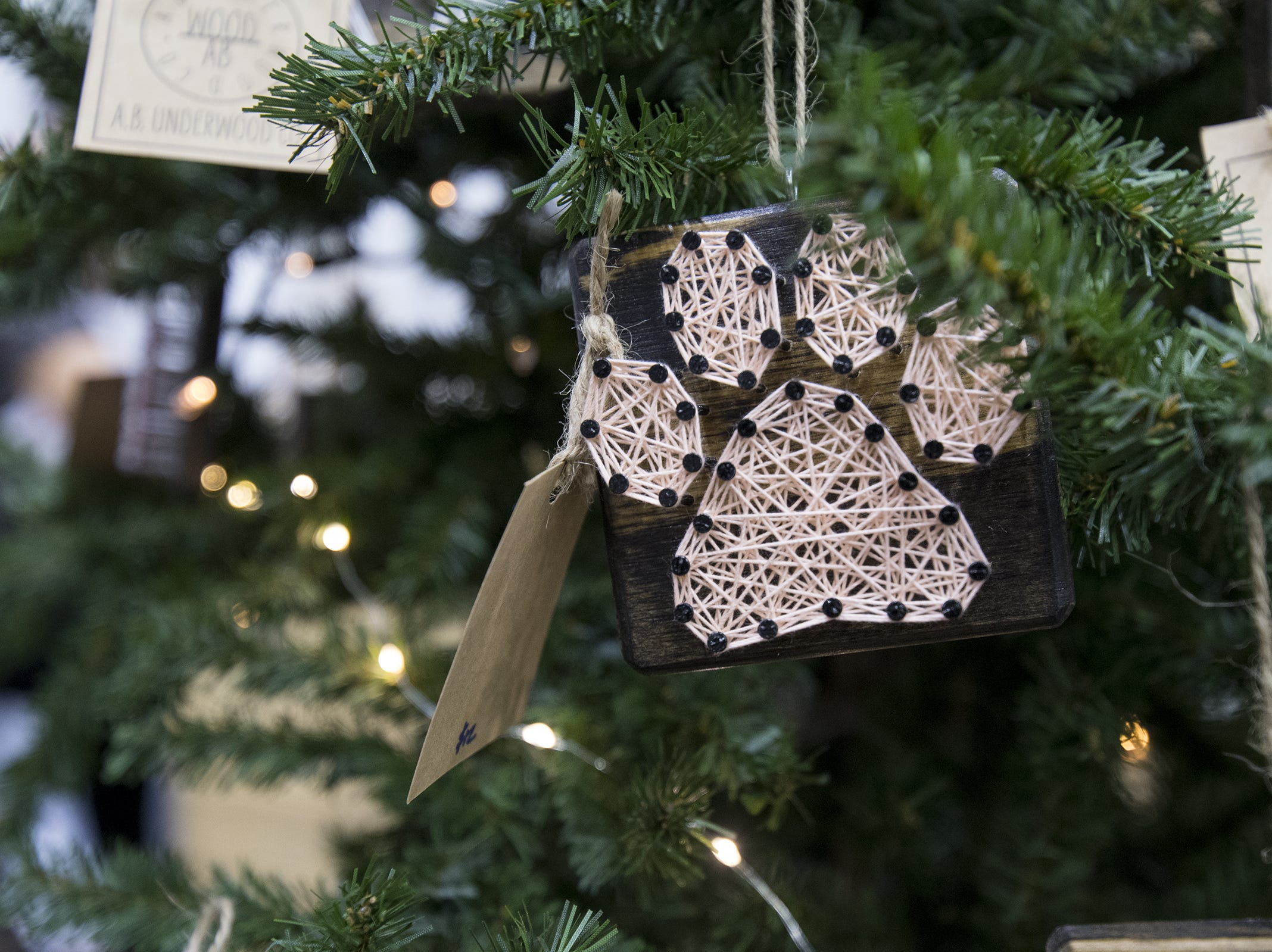 A.B. Underwood Co. sells handmade ornaments and gifts during the Greater Cincinnati Holiday Market at the Duke Energy Center Friday, November 2, 2018 in Cincinnati, Ohio.