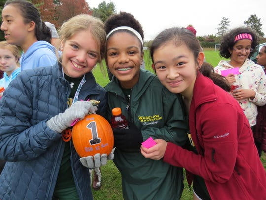 Bronwyn Russell of East Windsor, and eighth grade teammates Nelagh Matthews of Metuchen and Annie Gu of Edison.