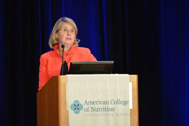 Veronique Cardon representing her data at the American College of Nutrition in DC in November 2017.
