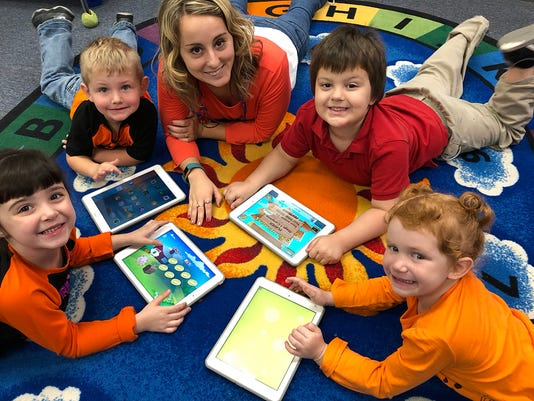 1amber With Four Students And Ipads Smaller