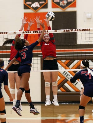 Kendyl Mick goes up for a block against Indian Valley.