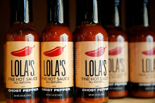 Hot sauce for sale at Lola's Fine Kitchen Wednesday, Oct. 31, 2018.