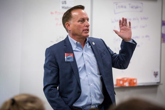 Secretary of State Paul Pate talks to Johnston High School students about the Iowa Youth Straw Poll, a non-scientific event held Tuesday, Oct. 30, 2018, around the state.