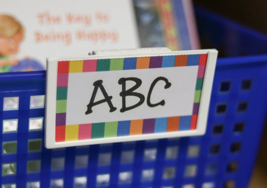 "An ""ABC"" label designates certain books in a school library at Woodbury Elementary in Marshalltown."