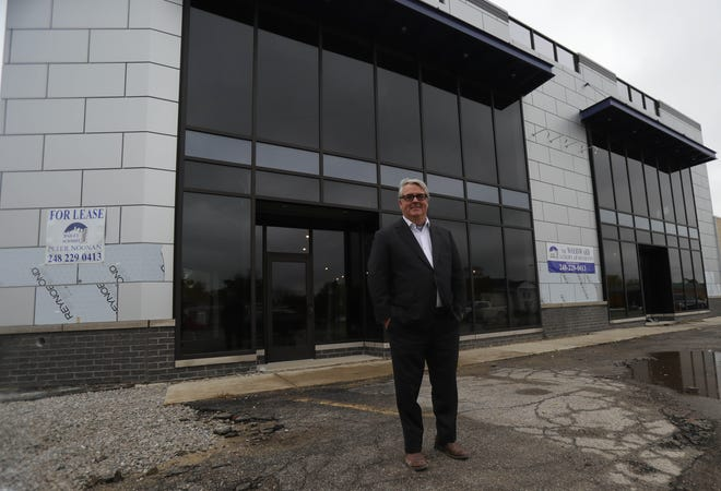 Peter Noonan stands in front of the Woodward, a luxury apartment and retail development going up right along the commercial strip of Woodward Avenue in Royal Oak. The apartments will rent for $6,800 a month and have access to a rooftop deck.