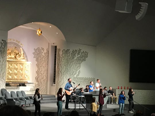 A song is recited during a vigil service for Pittsburgh synagogue victims held by Temple Israel in West Bloomfield on Oct. 30, 2018, Tuesday. Teenagers helped lead the service, calling for an end to hate and violence. The temple is one of the biggest Reform congregations in the U.S.