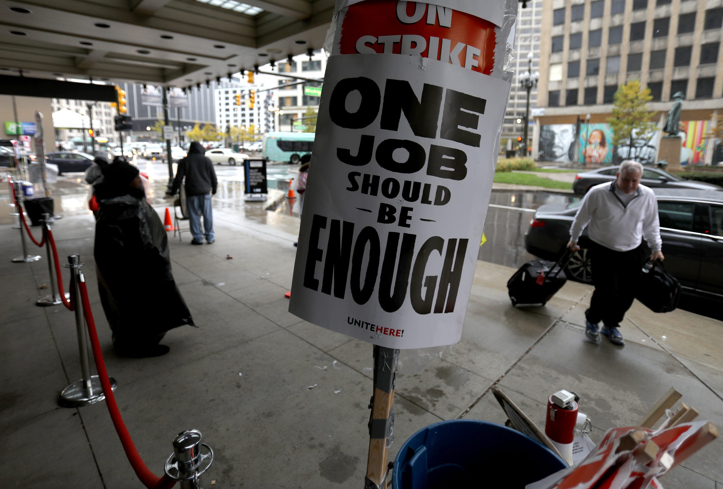 Over 130 workers in unions in Detroit have been on strike in front of the Westin Book Cadillac for the past month. Under the rain on Thursday, November 1, 2018, a handful of them march in front of the main entrance to the sound of a beating drum.
