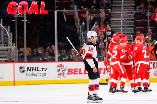 Detroit Red Wings right wing Martin Frk (42) is congratulated by teammates after scoring in the first period against the New Jersey Devils at Little Caesars Arena on Thursday, Nov. 1, 2018.