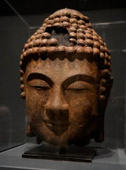 "A 9th-century, cast iron ""Head of Buddha"" in the Detroit Institute of Arts' new Asian Wing, opening Nov. 4."