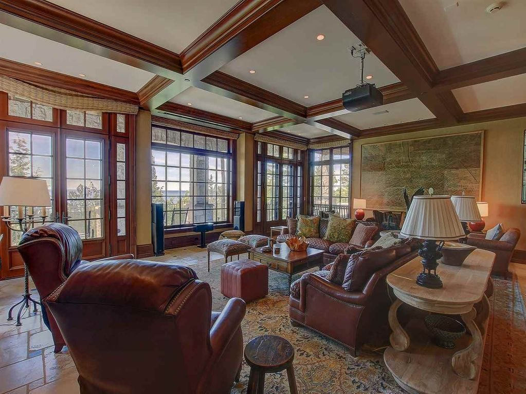 Among the interior features are a fireplace, vaulted ceiling, wood floors, a range, central air and ceiling fans.