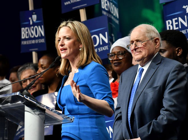 FILE - Secretary of State candidate Jocelyn Benson, left, speaks at the Michigan Democratic convention at Cobo Center in Detroit on April 15, 2018. Behind her is former U.S. Sen. Carl Levin, right.
