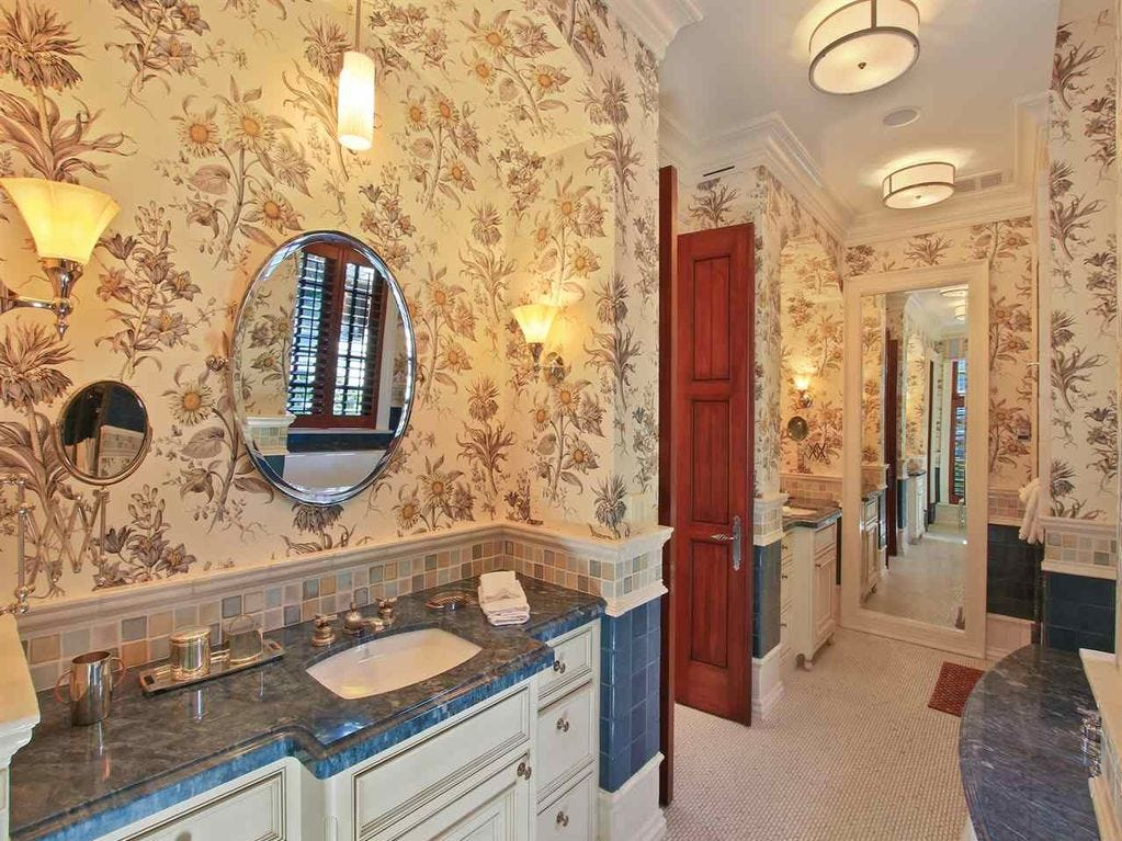 Built in 2003, the mansion has six bedrooms, seven full baths and three half baths.