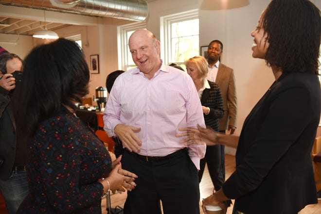 Retired Microsoft CEO Steve Ballmer, center, speaks Friday with Katrina McCree, right, and Cecily King at the Commons, a coffee shop and coin laundry created by the Mack Avenue Community Church Community Development Corp.